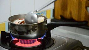 Cooking Octopus and Squid boiled stock footage