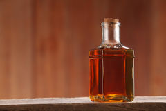 Cooking oil. Bottle of palm oil on the wooden background Royalty Free Stock Image