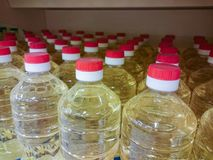 Cooking oil bottles with red caps on shelf in supermarket. Selective focus. royalty free stock images