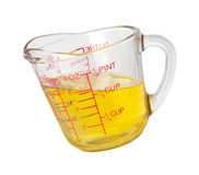 Cooking Oil in Measuring Cup (with clipping path). Isolated on white. Isolation is on a transparent layer in the PNG format royalty free stock photos