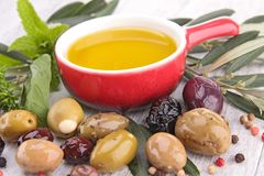 Cooking oil and olive Stock Photos