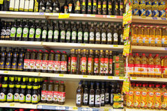 Olive Oil Bottles at Supermarket Stock Photo