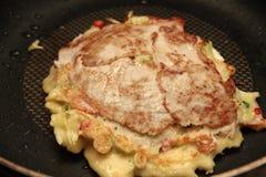 Cooking Okonomiyaki Japanese Cabbage Pancake Recipe. Homemade ,Cooking  Okonomiyaki Japanese Cabbage Pancake Recipe is fried mixed vegetable flour with meat Stock Image