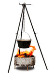 Cooking in old cast-iron on tripod Stock Photography
