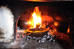 Cooking in an old fireplace Stock Photography