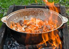 Cooking on open fire Royalty Free Stock Images