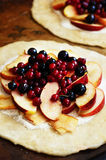 Cooking open pie or galette with apples and berries Stock Photography