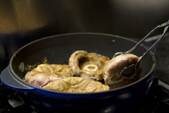 Cooking osso buco in pan Royalty Free Stock Photo