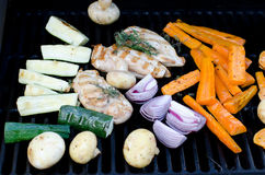 Cooking on an outdoor grill Royalty Free Stock Image