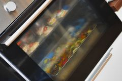 Cooking in an oven royalty free stock photos