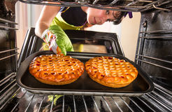 Cooking in the oven at home. Royalty Free Stock Images