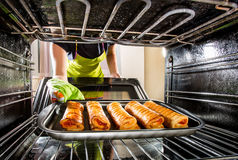 Cooking in the oven at home. Royalty Free Stock Photography