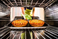 Cooking in the oven at home. Royalty Free Stock Image