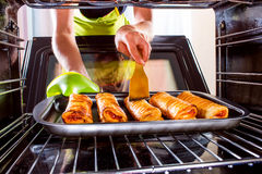 Cooking in the oven at home. Royalty Free Stock Photos