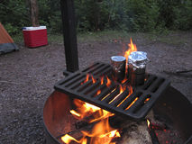 Cooking Over a Campfire. Cooking Cans of Beans Over a Campfire Stock Photos