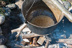 Cooking over a campfire Stock Image