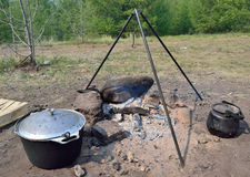 Cooking over a campfire in field conditions Royalty Free Stock Image