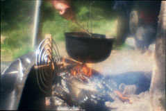 Cooking over a campfire Royalty Free Stock Image