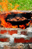 Cooking Over Open Fire Royalty Free Stock Images
