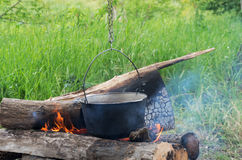 Cooking over an open fire Stock Photography