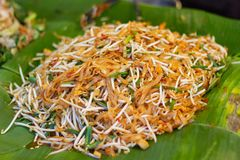Cooking Pad Thai noodles, Thai street food in the market popular stock photography