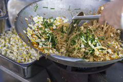 Cooking pad thai by stir frying noodle, Chinese leek, slice tofu Stock Photography