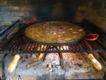 Cooking paella on the grill Stock Image