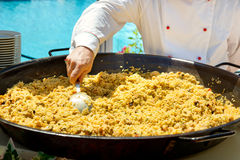 Cooking paella at an outdoor restaurant Stock Photos