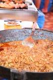 Cooking in paella pan outdoor restaurant Stock Image