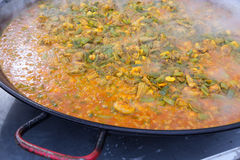 Cooking paella typical from Valencia Spain Royalty Free Stock Images