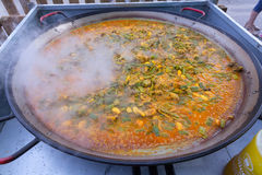 Cooking paella typical from Valencia Spain rice Royalty Free Stock Images