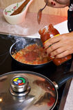 Cooking in pan Royalty Free Stock Photo