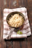 Cooking pan with rice. On wood background stock photos