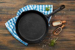 Cooking pan and spices Royalty Free Stock Photo
