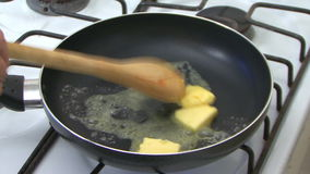 Cooking with pan stock video footage