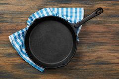 Cooking pan and towel Stock Images
