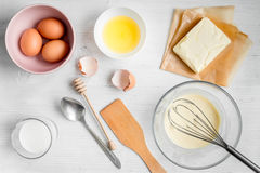 Cooking pancake on white background top view ingredients for making.  Stock Images