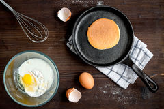 Cooking pancake on wooden background top view ingredients for making.  Royalty Free Stock Photos
