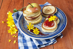 Cooking pancakes for dessert. Pancakes with jam and apple for breakfast, delicious and nutritious breakfast, the use of fruits for desserts Royalty Free Stock Photo
