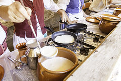 Cooking pancakes on a fair Royalty Free Stock Images