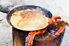 Cooking pancakes on fire Stock Photos