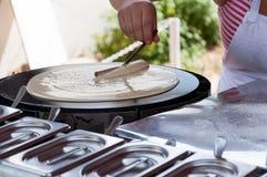 Cooking pancakes Royalty Free Stock Image