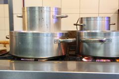 Cooking pans. Photograph of cooking pans on fire stock photo