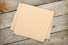 Cooking paper over wooden table Stock Image