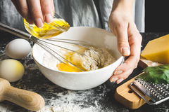 Cooking pasta by chef in kitchen on dark background Royalty Free Stock Photo
