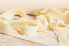 Cooking pasta fettuccine or tagliatelle dough Royalty Free Stock Images