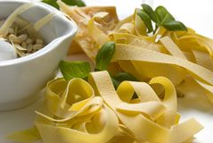 Cooking pasta with pesto Stock Photo