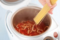 Cooking pasta with squid Stock Photos