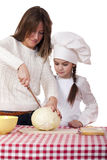 Cooking and people concept. Little girl in cook hat and mother, isolated on white background stock photo