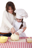 Cooking and people concept. Little girl in cook hat and mother, isolated on white background stock images
